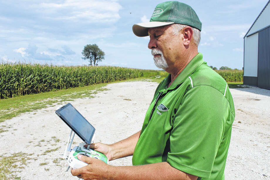 Todd Manning, the crop insurance coordinator at Country Financial, navigates a drone over a cornfield for insurance-adjusting information. Photo: Nick Draper | Journal-Courier