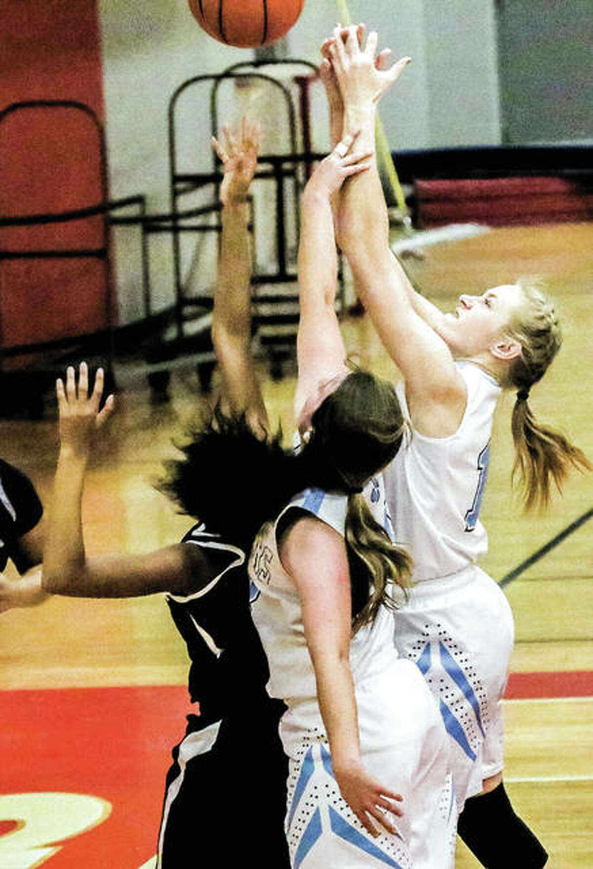 Jersey's Abby Manns, center, scored nine points and Lauren Brown added four points in their team's loss to Breese Mater Dei in the Alton Girls Tip-Off Classic Wednesday night at Alton High. They are pictured in action Monday night against Springfield Southeast.