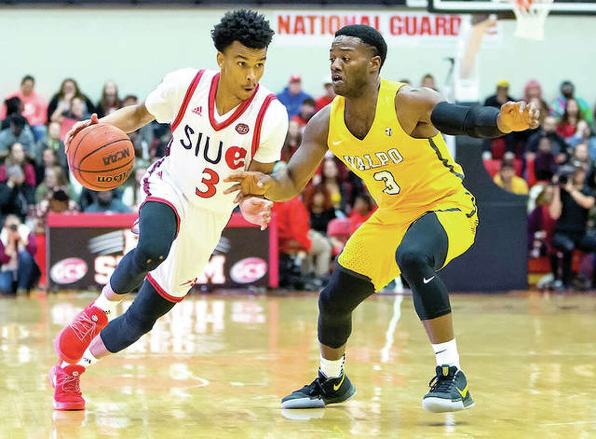 Daniel Kinchen of SIUE, left, drives against Max Joseph of Valparaiso Wednesday night at the Vadalabene Center. Kinchen scored 21 points, but the Cougars lost 94-69