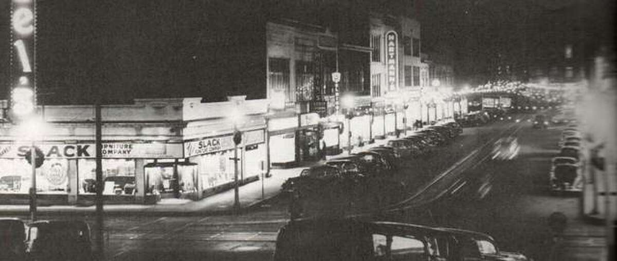 """In December 1939, West Third Street was decorated for Christmas, and parking was at a premium on the busy street. Downtown of that day had a variety of retail shops, professional offices, and restaurants. The merchants organization Downtown Alton, Incorporated, was fond of saying """"you can get it all downtown."""" Dependable streetcar service made it possible for everyone to go downtown."""