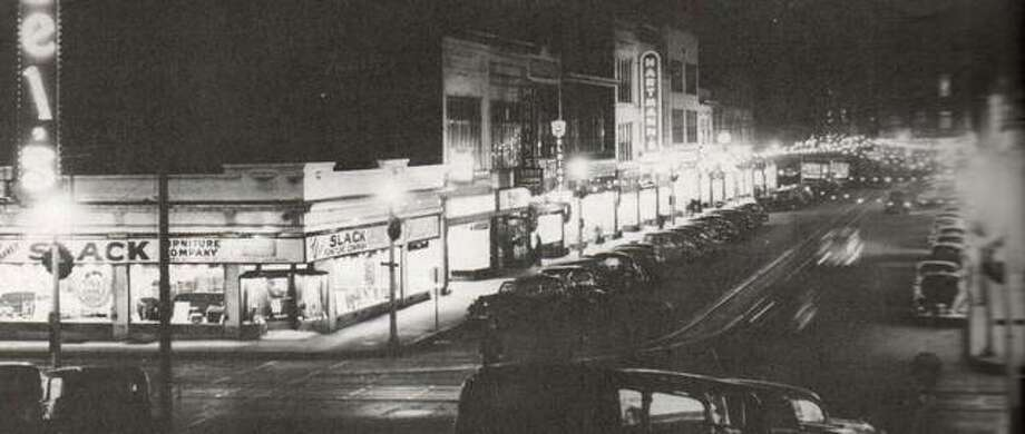 "In December 1939, West Third Street was decorated for Christmas, and parking was at a premium on the busy street. Downtown of that day had a variety of retail shops, professional offices, and restaurants. The merchants organization Downtown Alton, Incorporated, was fond of saying ""you can get it all downtown."" Dependable streetcar service made it possible for everyone to go downtown. Photo: File Photo"