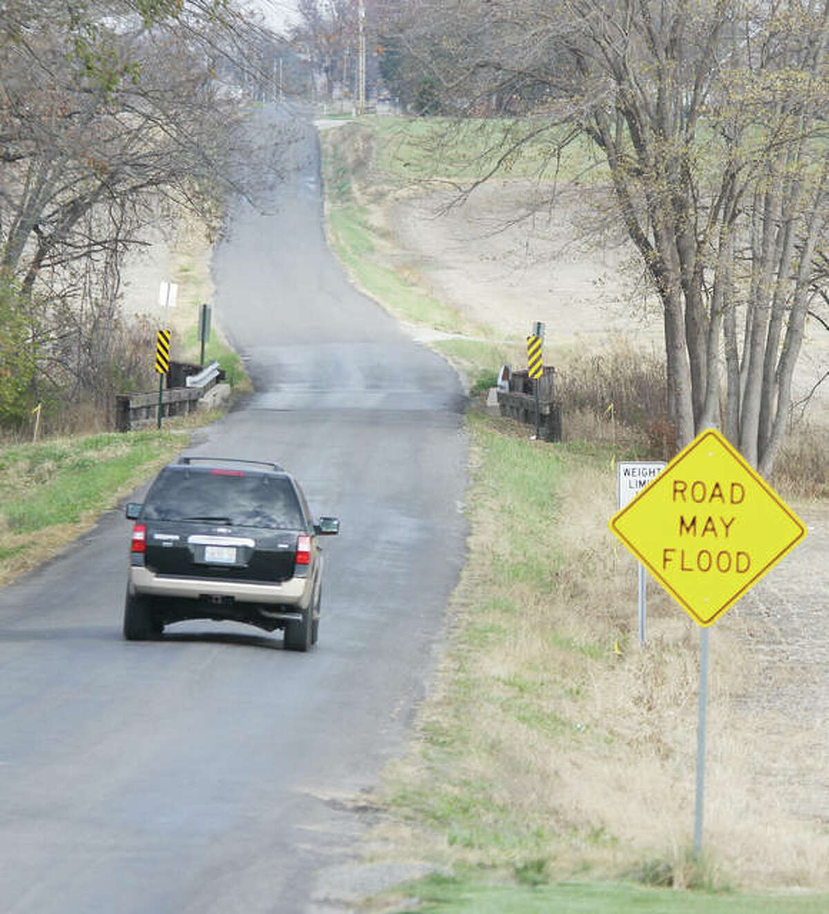 A vehicle approaches the Heeren Bridge over Indian Creek on Buchta Drive. Fort Russell Township officials have asked for county help to replace the bridge, which has a number of structural deficiencies.