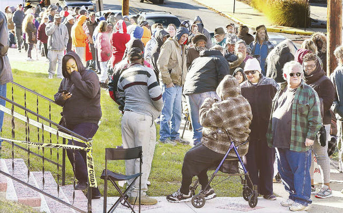 Hundreds of people stand in line, some since about 6 a.m., Thursday for the fourth annual frozen turkey giveaway at the Alton Salvation Army, paid for by the TorHoerman Law firm of Edwardsville. The giveaway began at 10 a.m.