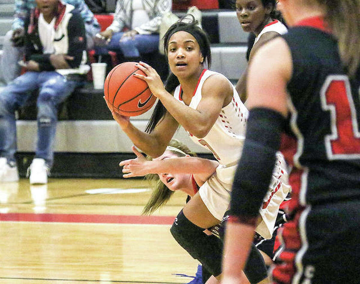 Alton's Jayla Fox looks for someone to pass to during action in the Alton Tip-Off Classic. Fox, shown in action against Calhoun Tuesday, scored four points Wednesday in a 55-28 loss to Breese Central.