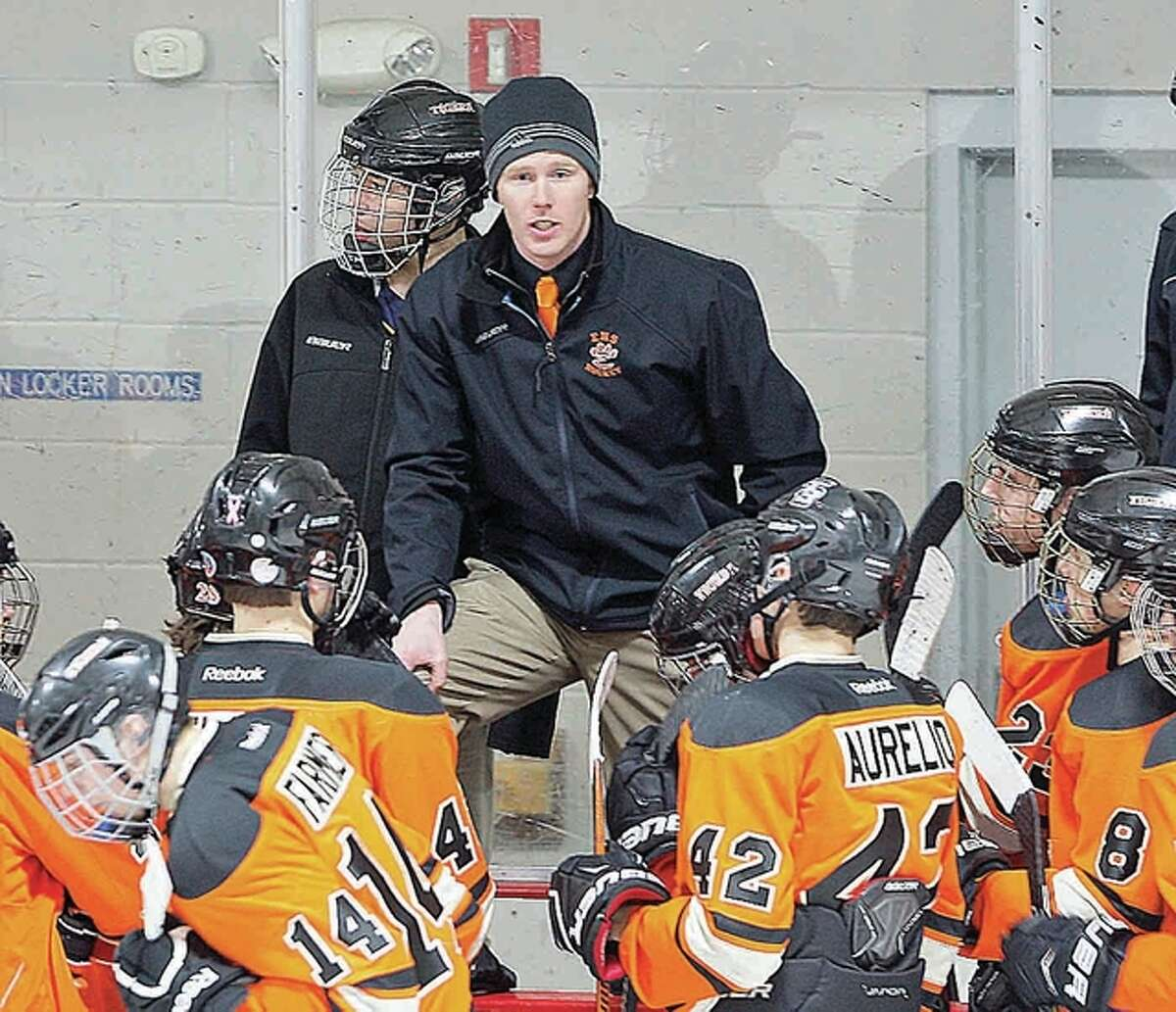 Edwardsville hockey coach Jason Walker's team dropped a 6-3 Mid-State Hockey Association decision to DeSmet Thursday night at the East Alton Ice Arena. Walker is shown addressing the Tigers during a previous game at East Alton.