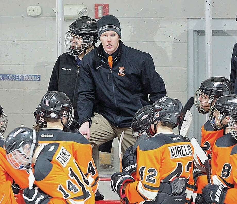 Edwardsville hockey coach Jason Walker's team dropped a 6-3 Mid-State Hockey Association decision to DeSmet Thursday night at the East Alton Ice Arena. Walker is shown addressing the Tigers during a previous game at East Alton. Photo: Telegraph File Photo