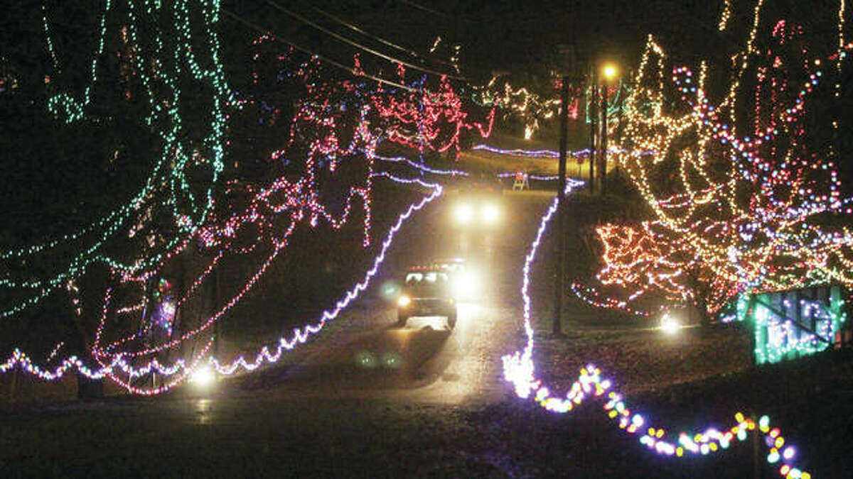 Vehicles head toward the exit of Christmas Wonderland, the annual holiday light display at Rock Spring Park in Alton.