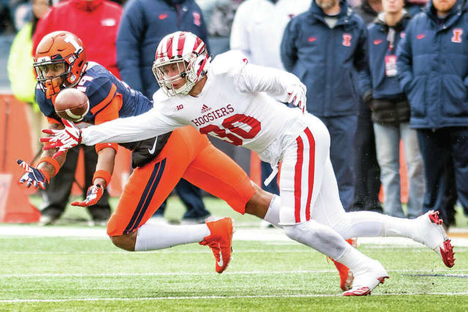 Indiana defensive back Chase Dutra (30) defends a pass intended for Illinois tight end Louis Dorsey (19) and is called for pass interference in last week's Illini home loss to the Hoosierts. Illinois will play at Ohio State Saturday. Photo: AP