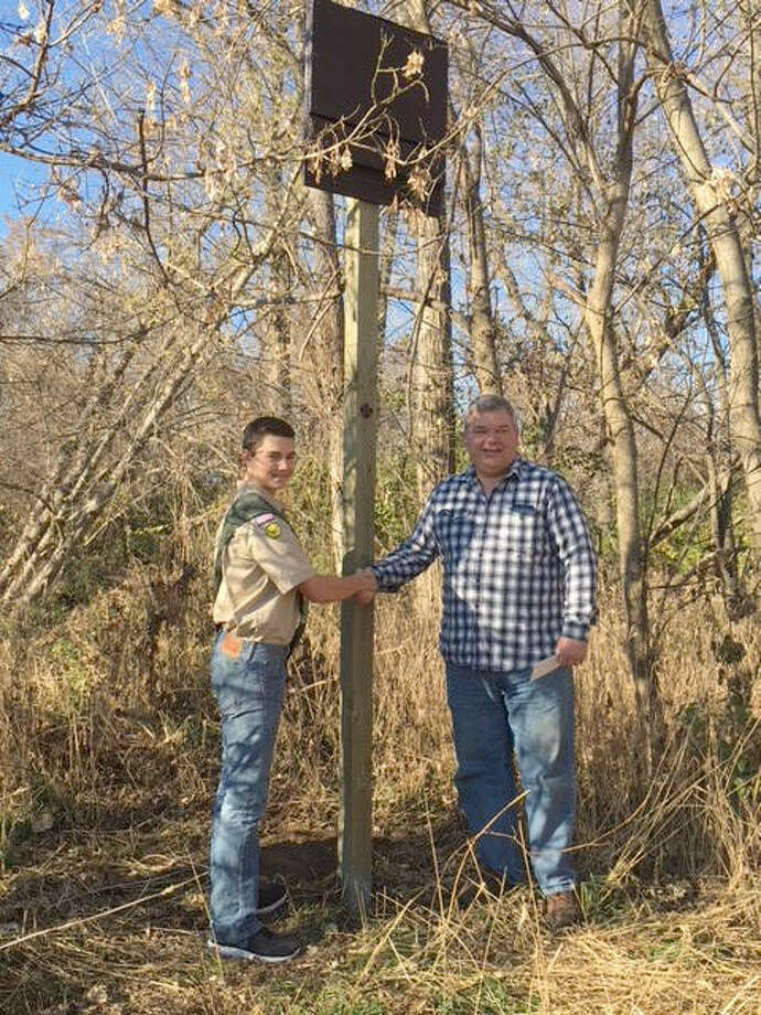 Bethalto Mayor Alan Winslow shakes the hand of local Boy Scout Ethan Scott, who recently installed three new bat houses at the Bethalto Sports Complex as part of his Eagle Scout project. Photo: For The Telegraph