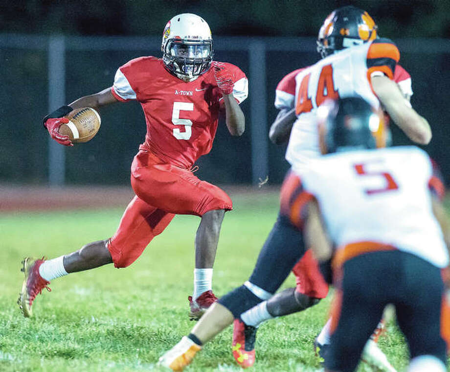 Alton's Darrell Smith (5) has been named to the Illinois High School Football Coaches Association Class 7A All-State Team. Smith, gained 1,324 yards rushing on 126 carries and scored 17 touchdowns. Photo: Scott Kane | For The Telegraph