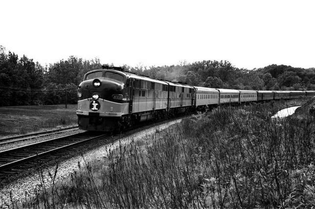 """The final run of Illinois Central's St. Louis to Chicago """"Green Diamond"""" is passing through Glen Carbon near the old mine rescue station on May 19, 1968. The next day it will be renamed the """"Governor's Special"""" and will operate only between Chicago and Springfield. These tracks are now the Ronald J. Foster Heritage Trail."""