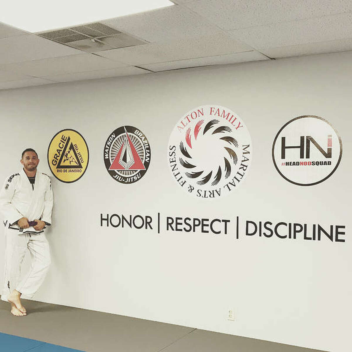 Alton Family Martial Arts and Fitness owner Adam Marburger stands in his newly-renovated space at Nautilus Fitness Center in Alton. Marburger hopes to improve lives through the discipline of martial arts.