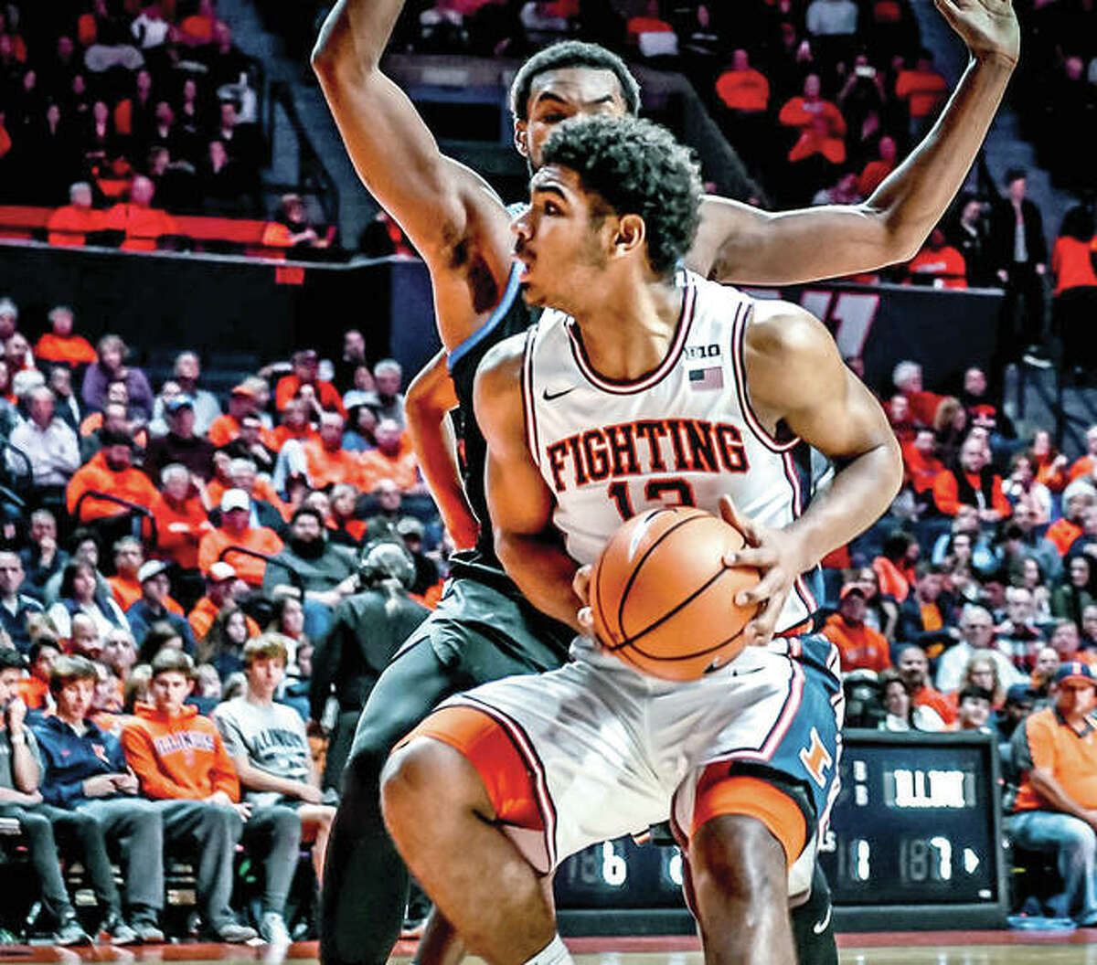 Illini Mark Smith, a freshman from Edwardsville, looks to the basket in Friday night's win over DePaul at State Far, Center. Smith led 3-0 Illinois with 21 points.