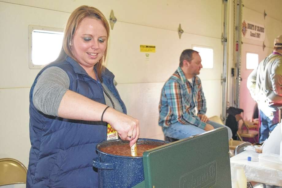 Nichole Mason of Winchester, cooking for Farmers State Bank of Winchester, stirs some chili in preparation for the beginning of the Winchester Chili Cook-off and Salsa Contest on Saturday. Photo: Nick Draper | Journal-Courier