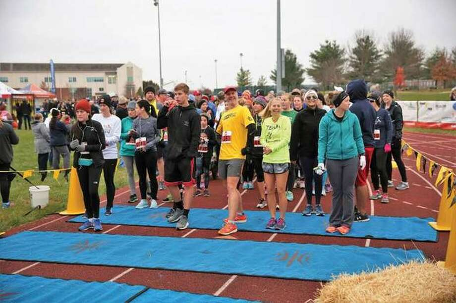 Participants await the start of the 2016 Neighbors in Need Turkey Trot. After maxing out participation at last year's Edwardsville High School location, the new SIUE location offers unlimited participation, and there's still time to register for the event. Photo: For The Telegraph