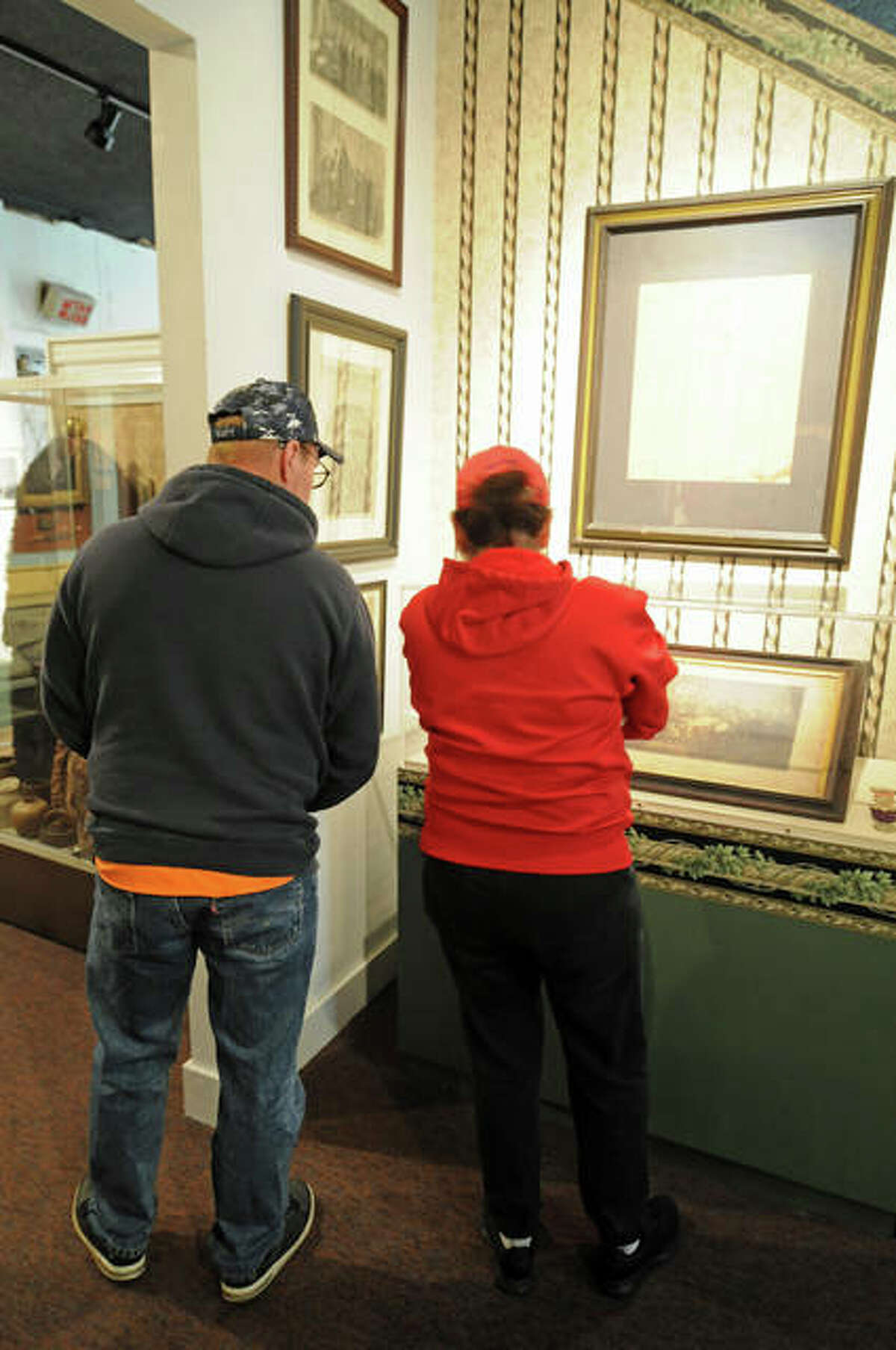 Two visitors view Lincoln items on Sunday at the Alton Museum of History and Art.