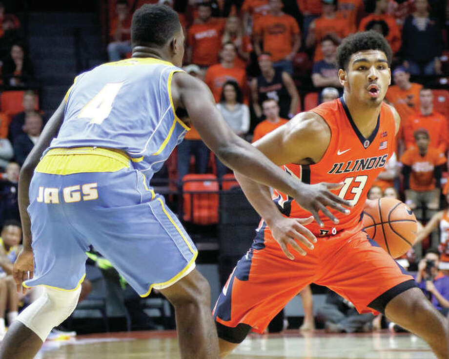 Illinois' Mark Smith (right), a freshman from Edwardsville, handles the ball against defensive pressure from Southern University's Chris Thomas during an Illini win Nov. 10 at State Farm Center in Champaign. Photo: Associated Press