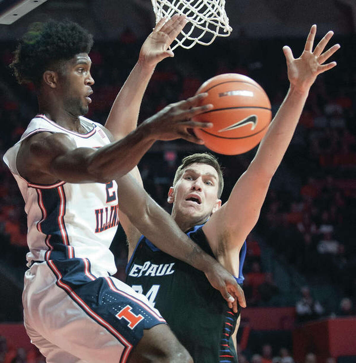 Illinois's Kipper Nichols (left), who passing around DePaul's Marin Maric in Champaign, had his first career double-double Sunday in Champaign.