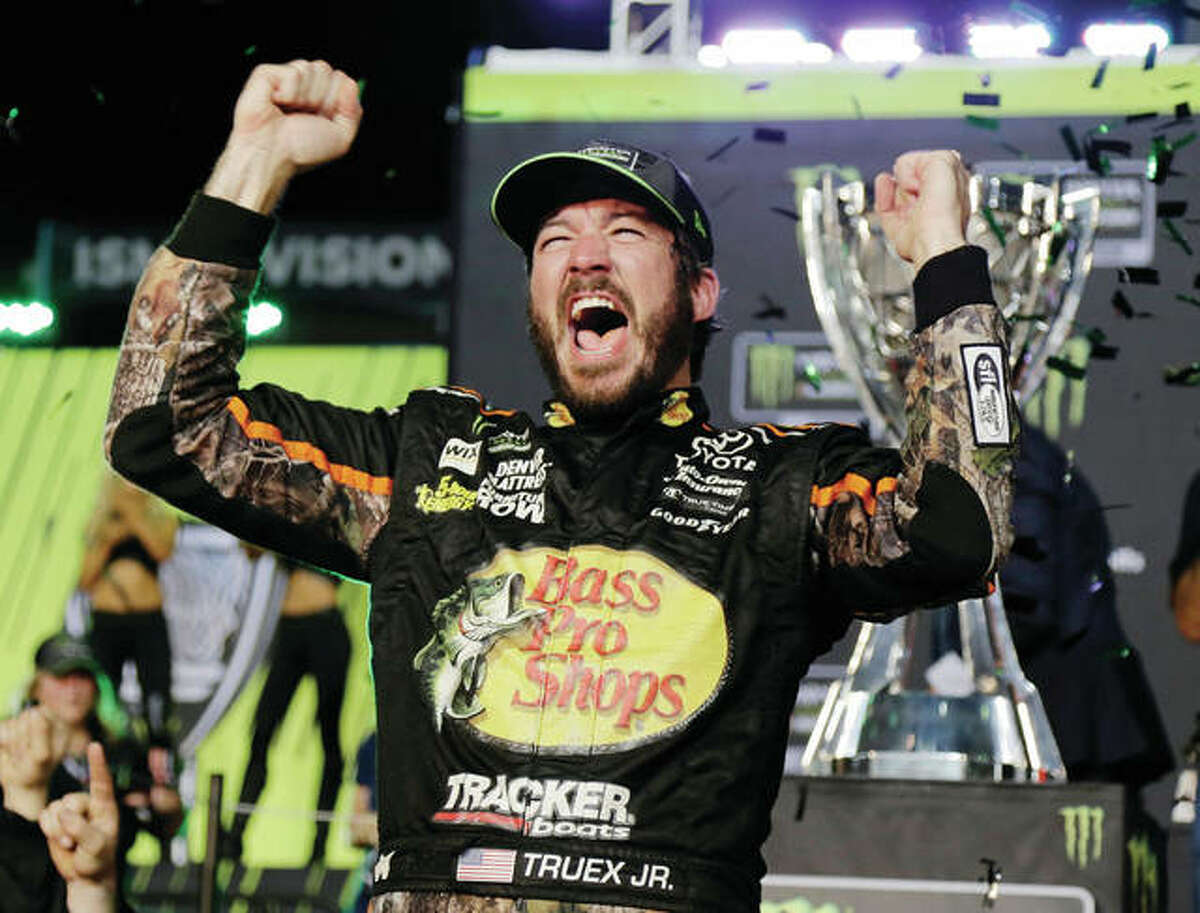 Martin Truex Jr. celebrates in Victory Lane on Sunday after winning the NASCAR Cup Series race and season championship at Homestead-Miami Speedway in Homestead, Fla.
