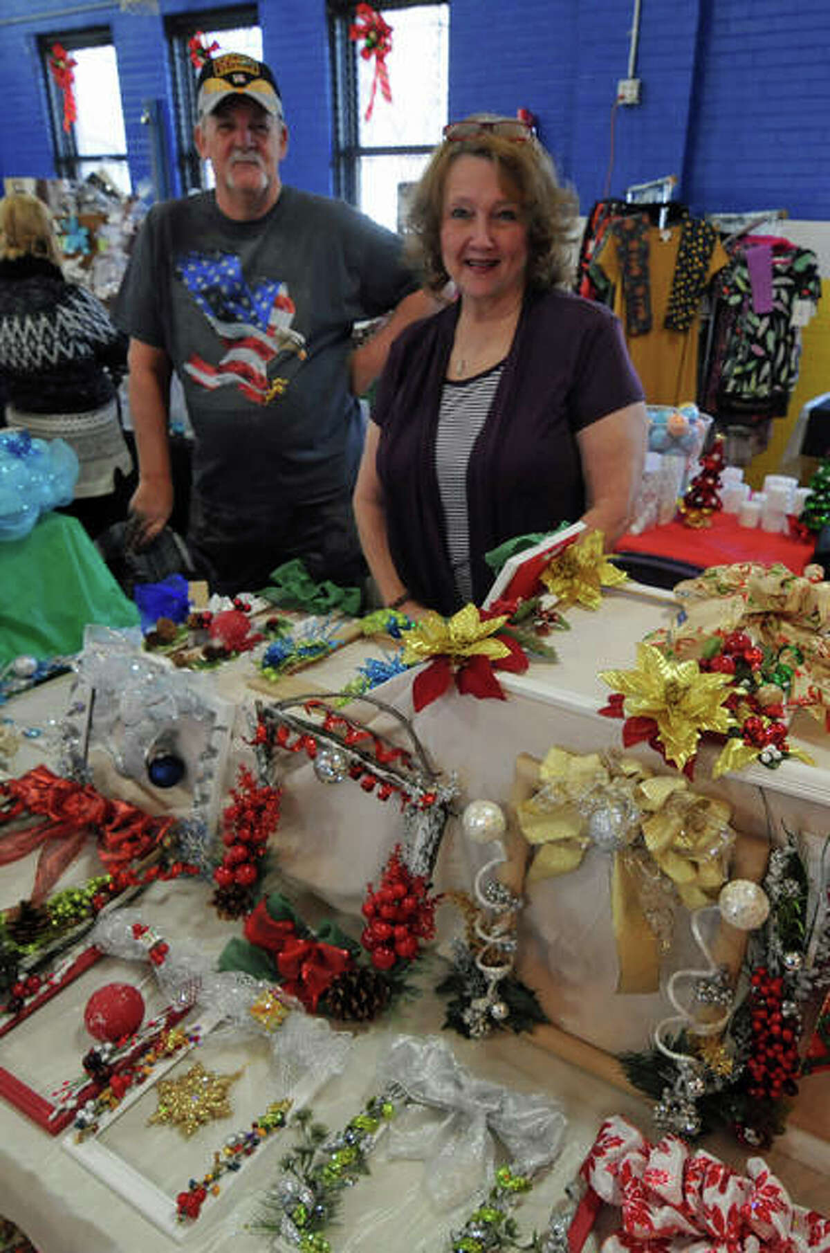 Bill Davis and Chris Eardley and their picture frame wreaths at the Old Cathedral Bazaar.