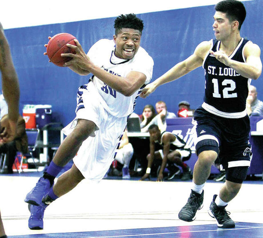 John Ekwomadu, left, a 6-foot-6 forward is one of only four sophomores on this season's Lewis and Clark Community College men's basketball team. Ekwomadu, from Lagos, Nigeria, is shown in action last season against St. Louis Community College. Photo: S. Paige Allen File Photo | For The Telegraph