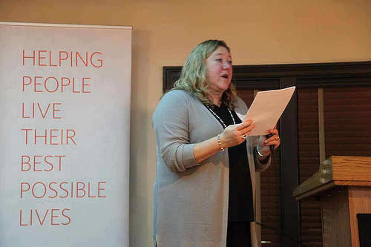 Cindy Smalley, 2017 campaign chair of the Southwest Illinois Division of United Way and director of marketing and communications of Cope Plastics, announces the campaign results at a victory celebration at the Argosy Casino in Alton Sunday evening.
