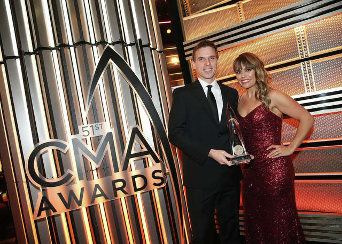 Jesse Tack and Amanda Valentine accept the Large Market Personality of the Year award at the Country Music Association Awards in Nashville.