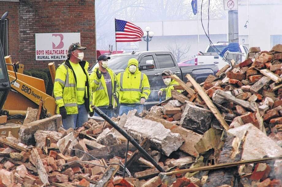 City crews survey a debris pile from Tuesday's downtown White Hall fire. Photo: David Blanchette | For The Journal-Courier