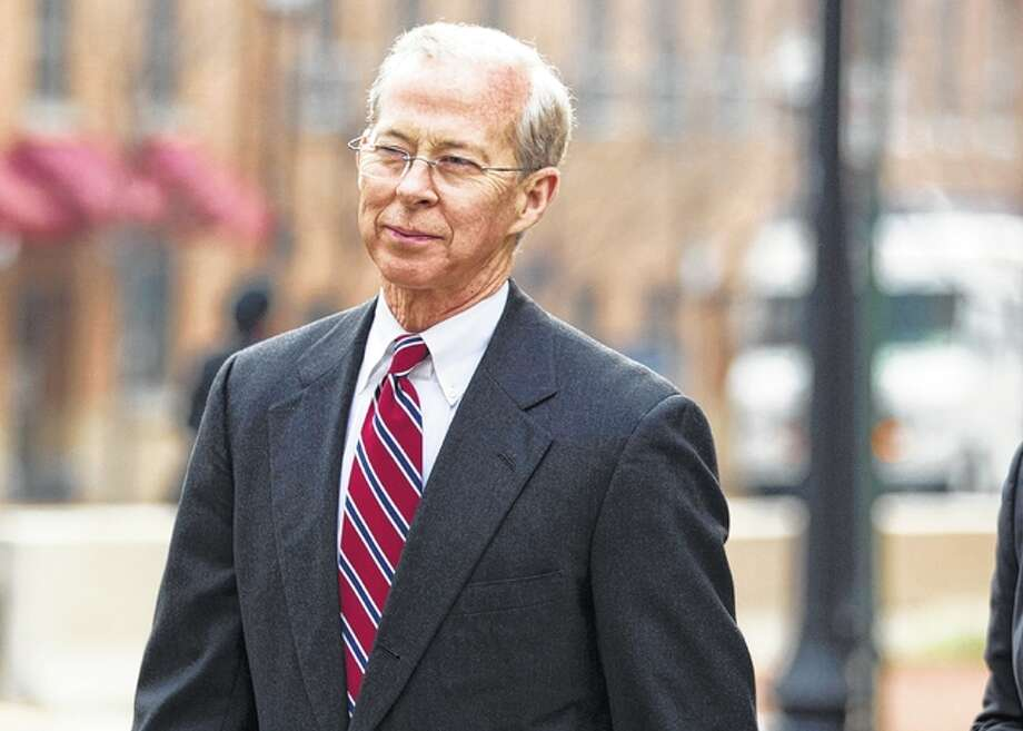 Evan Vucci | AP Dana Boente leaves federal court in Alexandria, Virginia. President Donald Trump fired acting Attorney General Sally Yates after she announced she would not defend his controversial immigration order. He named Boente, who has roots in Macoupin County, to serve in her place.
