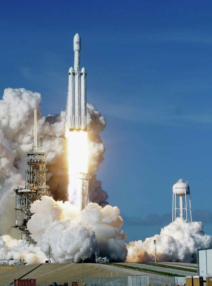 SpaceX on Tuesday sent its 230-foot Falcon Heavy rocket into orbit and returned its two side boosters safely to Earth. Photo: John Raoux, STF / Copyright 2018 The Associated Press. All rights reserved.