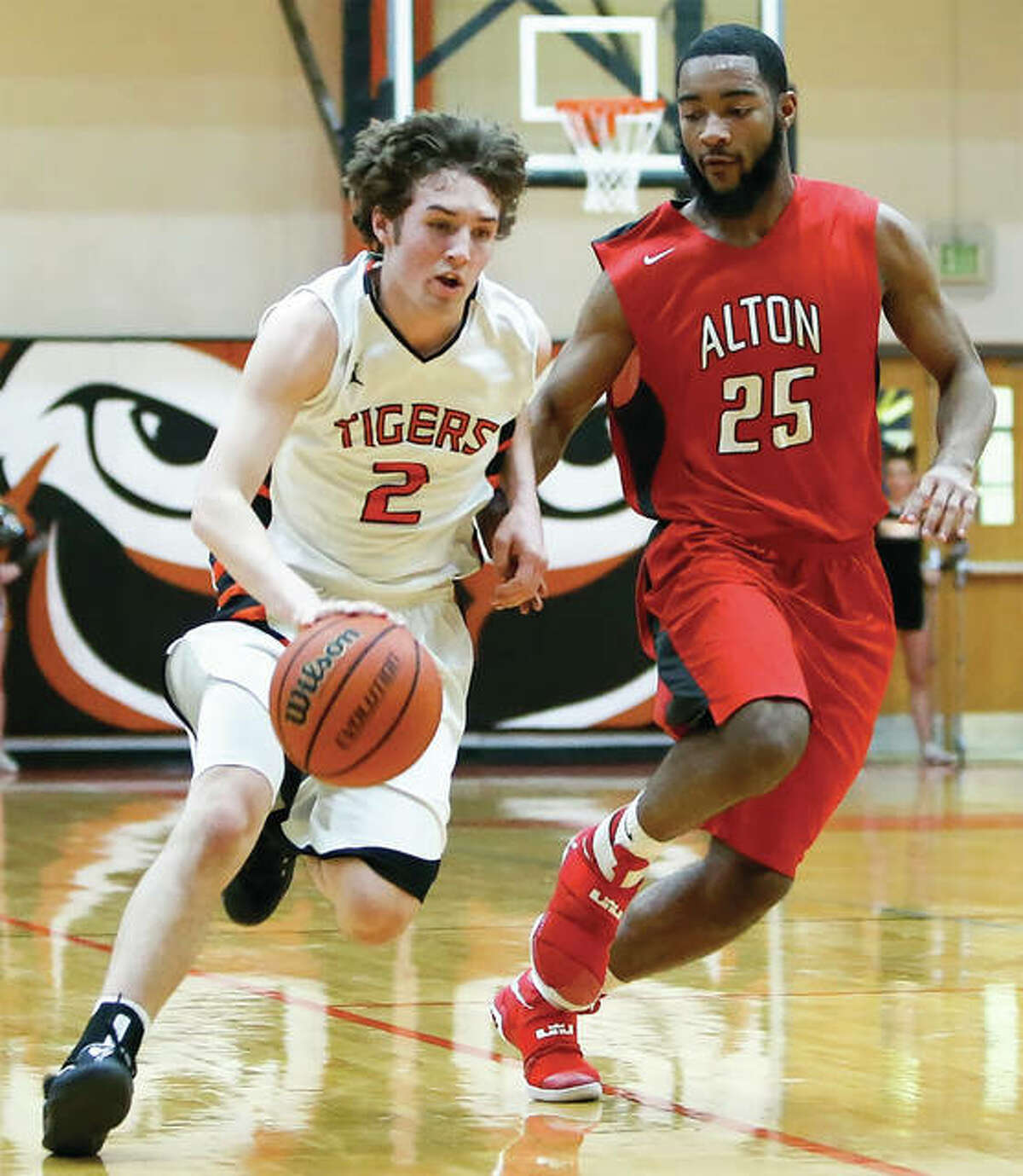 Edwardsville's Jack Marinko (left), shown driving on Alton's Maurice Edwards in a game last season in Edwardsville, is one of two starters back from last season's 30-2 squad.