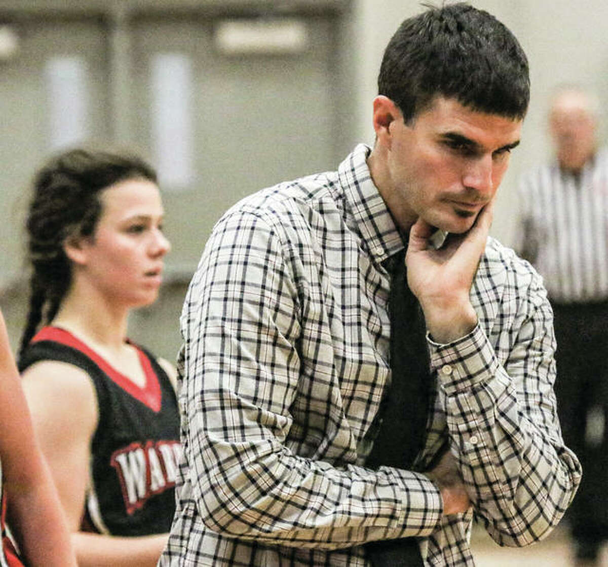 Calhoun coach Mark Hillen considers his options during a break in play at last week's Alton Tournament. The Warriors opened at home Tuesday and defeated Southwestern to give Hillen his first win as Warriors coach at Ringhausen Gym.