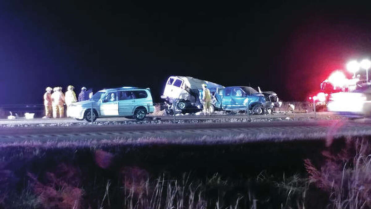 Multiple vehicles sit smashed after a tractor-trailer crashed into seven vehicles Tuesday night on Interstate 55 near Hamel.