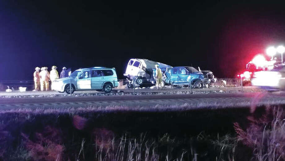 Multiple vehicles sit smashed after a tractor-trailer crashed into seven vehicles Tuesday night on Interstate 55 near Hamel. Photo: Melissa Pitts | For The Telegraph