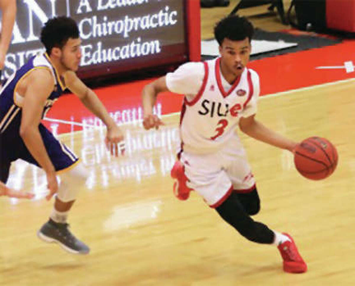 SIUE's Daniel Kinchen (right) drives past a Western Illinois defender during a game Wednesday night at Vadalabene Center in Edwardsville.