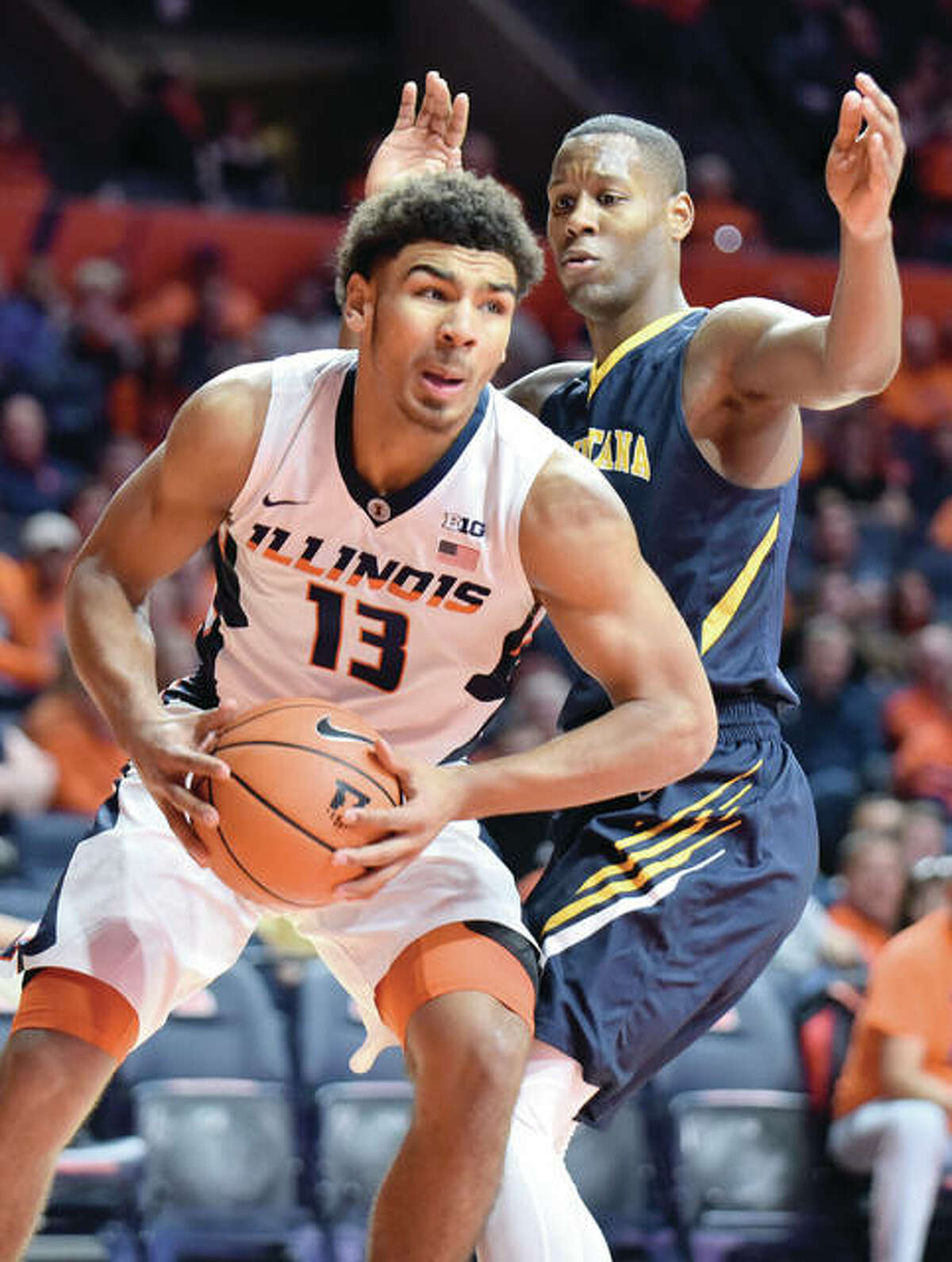 Illinois' Mark Smith (13), a freshman from Edwardsville, moves past Augustana's Chrishawn Orange during the first half of Wednesday night's game at the State Farm Center in Champaign. Smith scored 13 points and was one of five Illini in double figures.