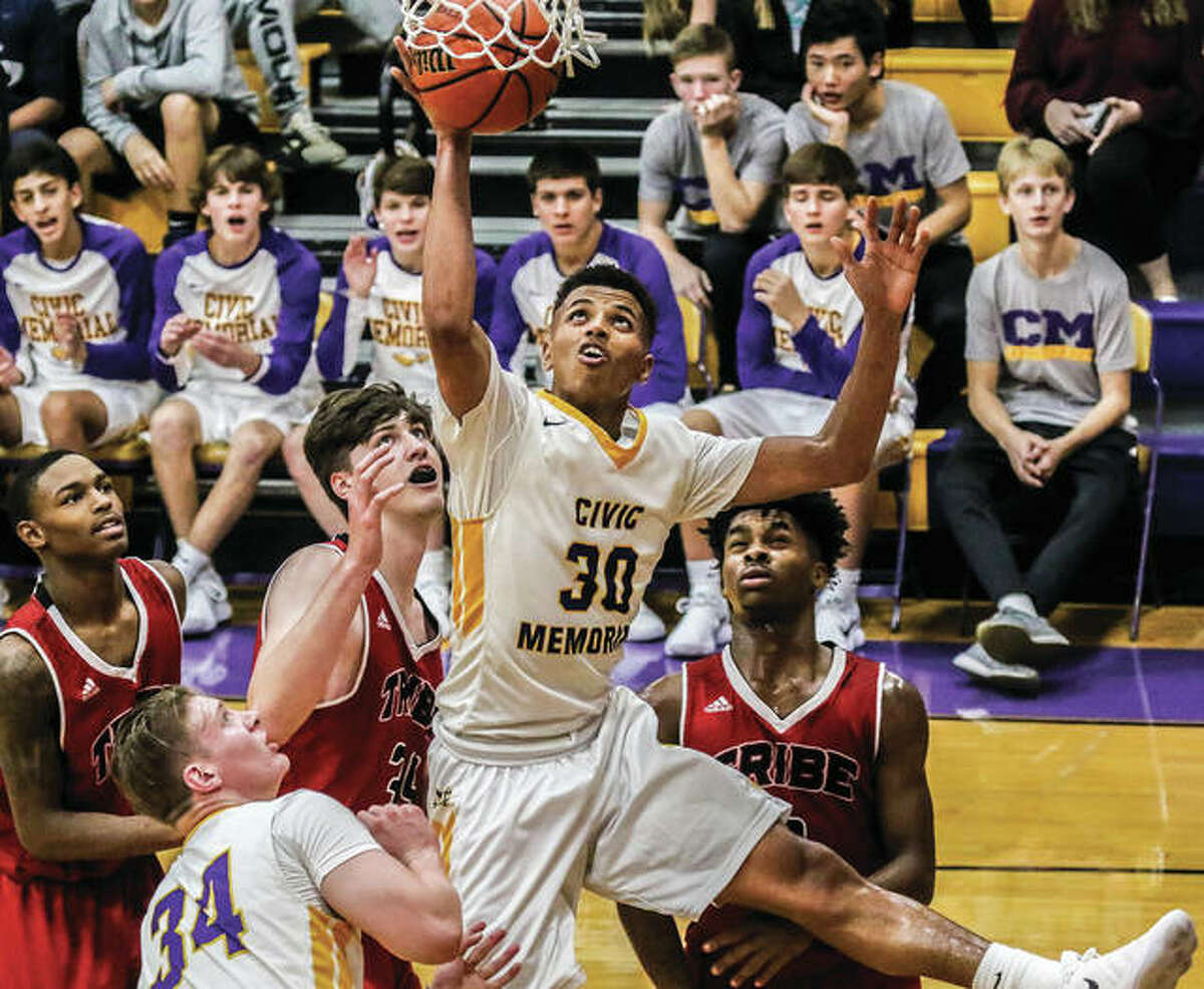 CM senior Jaquan Adams (30) sinks a bucket off his offensive rebound in traffic Wednesday night in the Eagles' 69-62 win over Granite City in the Stove Top Stuffing Tournament in Bethalto. Adams scored 27 points in the game, putting him over 1,000 career at CM.