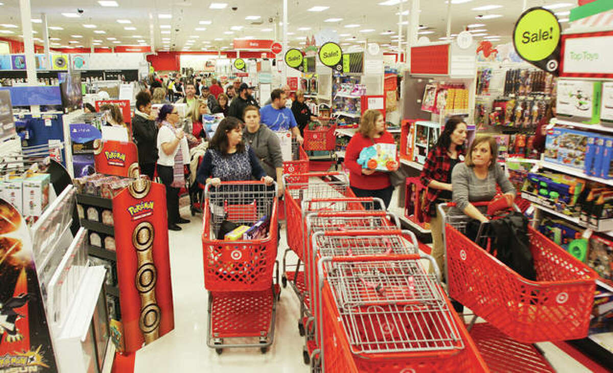 Thanksgiving day crowds work their ways through the aisles near electronics in the Alton Target store. Large crowds were reported at local stores for what has become the more common start of the Christmas shopping season than Black Friday.