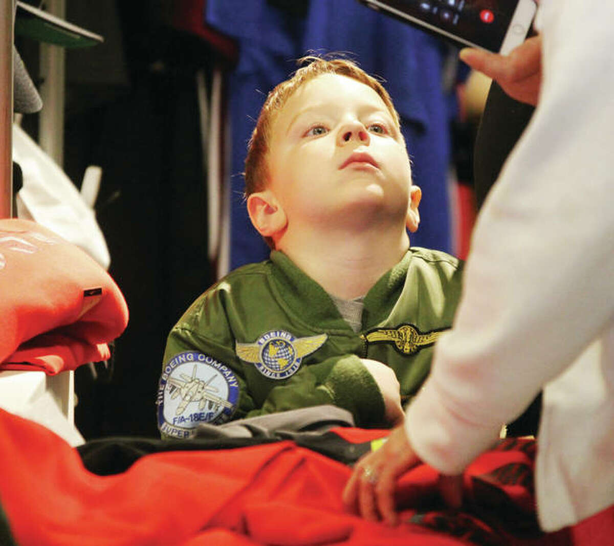 A bored Kevin Harris, 5, of Brighton, watches as his father, Ed Harris, and grandmother, Joan Harris, shop in the JC Penney store at Alton Square on Black Friday.