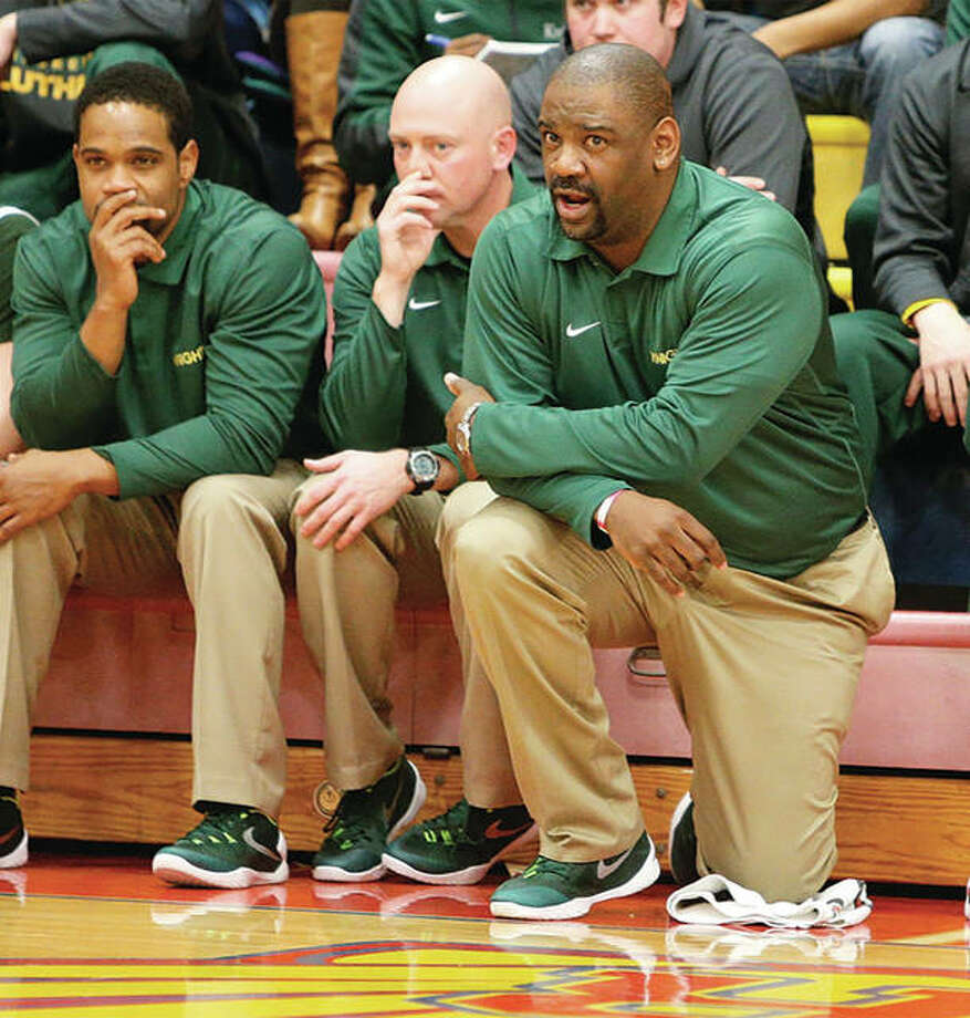 Metro East Lutheran coach Anthony Smith (right), shown kneeling in front of his team's bench during a Knights win at Roxana two seasons ago, has MEL in the championship game against top-seeded Marquette on Saturday night in the 37th annual Metro East Lutheran Thanksgiving Turkey Tip-Off Classic in Edwardsville. Photo: Scott Kane / For The Telegraph