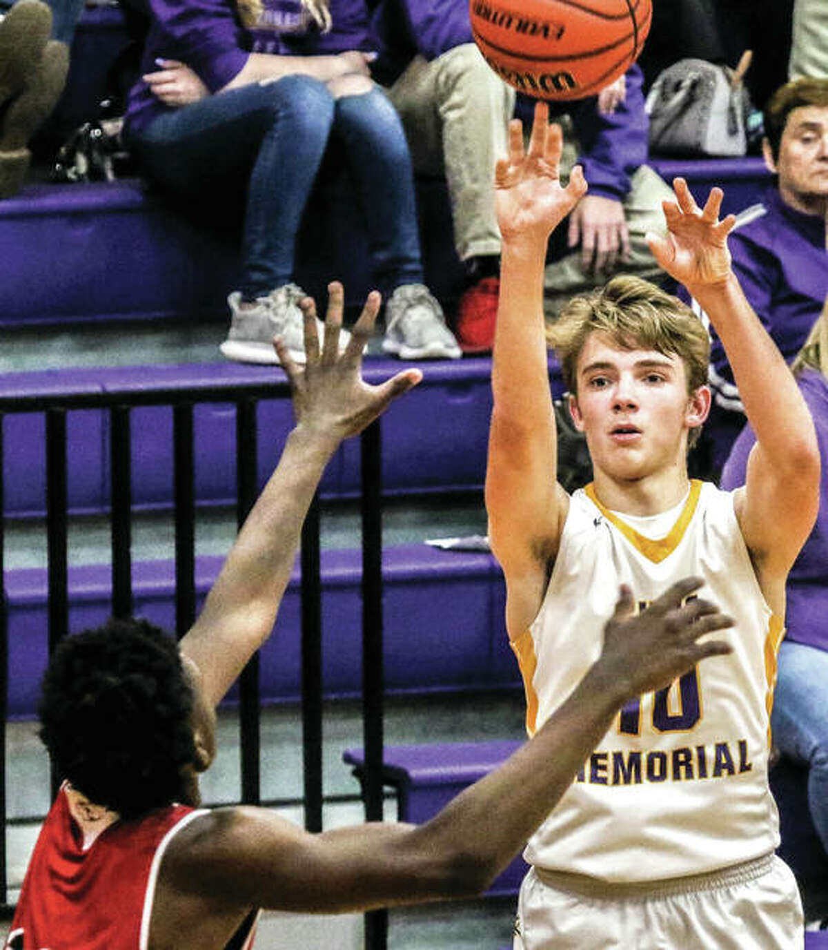 Civic Memorial's Bryce Zupan (right), shown shooting over a Granite City defender in an Eagles win Thursday in Bethalto, scored 17 points Friday night in an Eagles win at Nokomis.