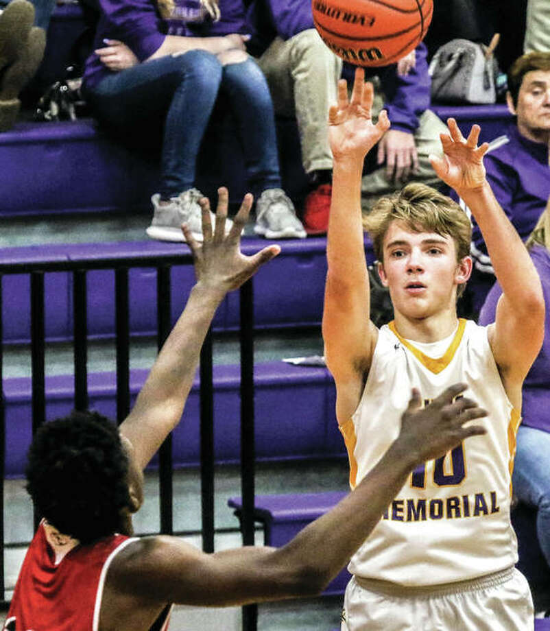 Civic Memorial's Bryce Zupan (right), shown shooting over a Granite City defender in an Eagles win Thursday in Bethalto, scored 17 points Friday night in an Eagles win at Nokomis. Photo: Nathan Woodside / For The Telegraph