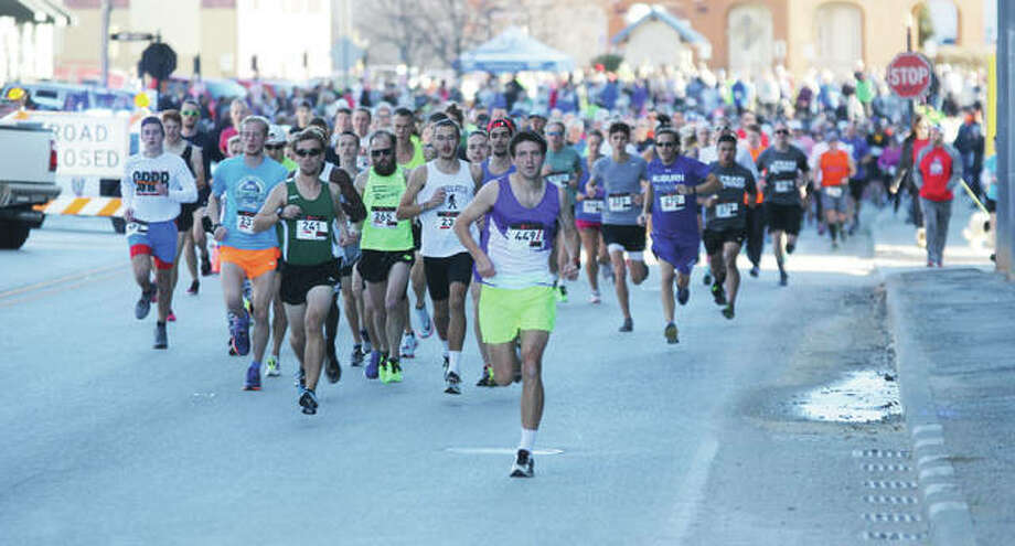 Runners take off at the start of the 58th annual Great River Road Run in downtown Alton Saturday. An estimated 1,000 runners participated in either a 2- or 10-mile run. The run is sponsored by the Alton Road Runners Club, and stems from Alton High School track and cross-country coach Jim Wigger taking his team out for a post-Thanksgiving run.