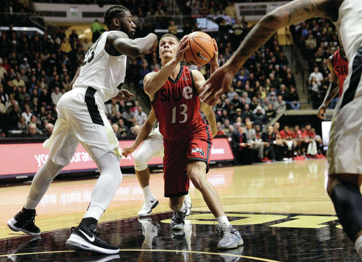 SIUE guard Christian Ellis (13), shown going to the basket against Purdue's Jacquil Taylor (left) during a game Nov. 10 in West Lafayette, Ind., scored a career-high 19 points Saturday against Creighton in Omaha, Neb.