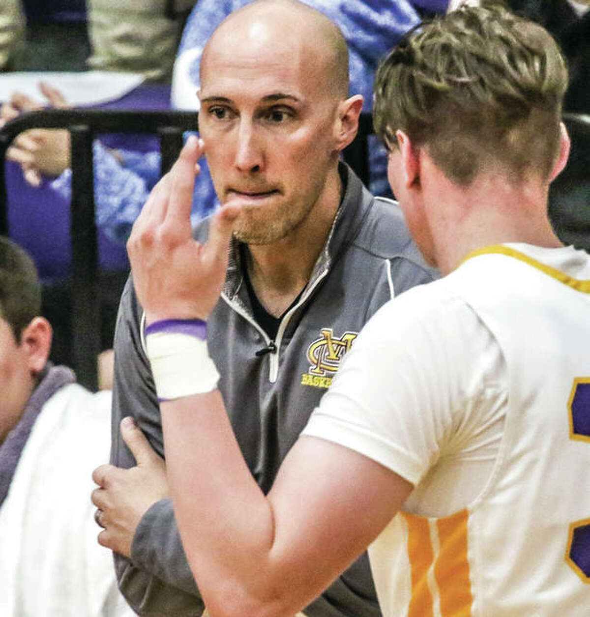 CM coach Ross Laux (left) gets input from Eagles senior Geoff Withers during the Eagles' victory over Granite City on Wednesday in Bethalto. CM completed its 4-0 run to the title of the Stove Top Stuffing Tournament by beating Triad on Saturday night in Troy.