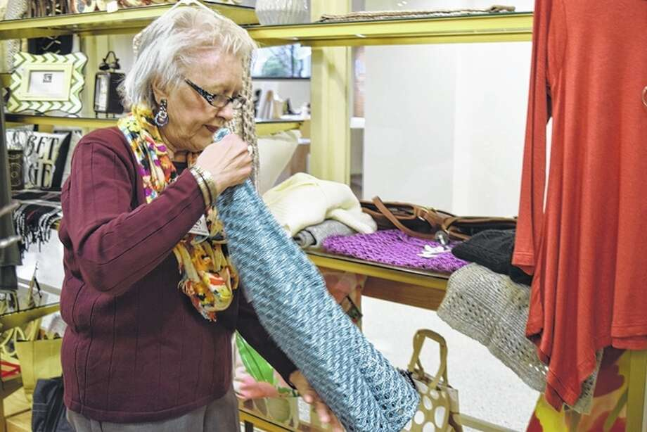 Sonie Smith folds a sweater in the gift shop at Passavant Area Hospital on Monday. Photo: Samantha McDaniel-Ogletree | Journal-Courier