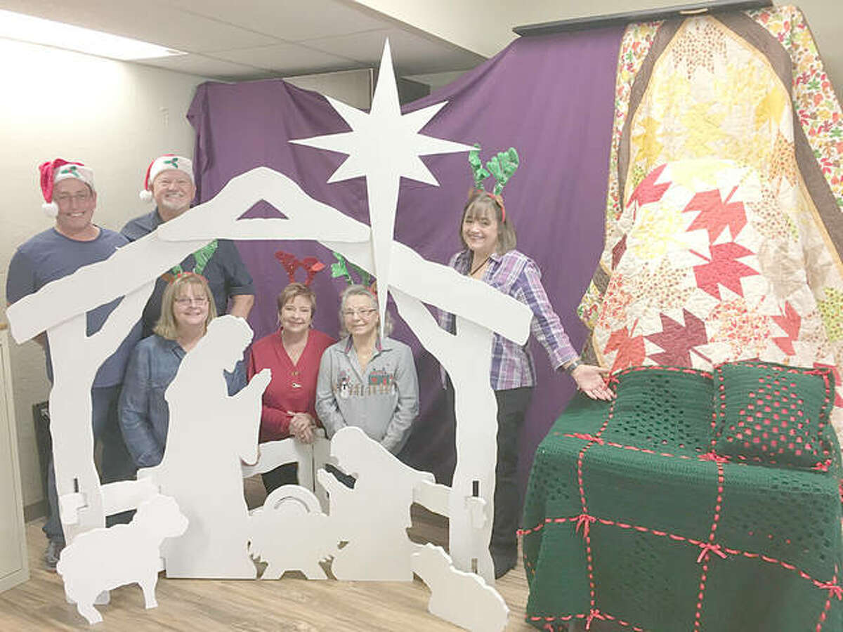 Announcing the Our Lady Queen of Peace raffle items for this year's Smorgasbord Dinner and Craft Bazaar are chairmen, from left, Tim Zacha, Dan Smith, Linda Zacha, Martha Smith, Fran Nappier and Maryjo Flaherty.