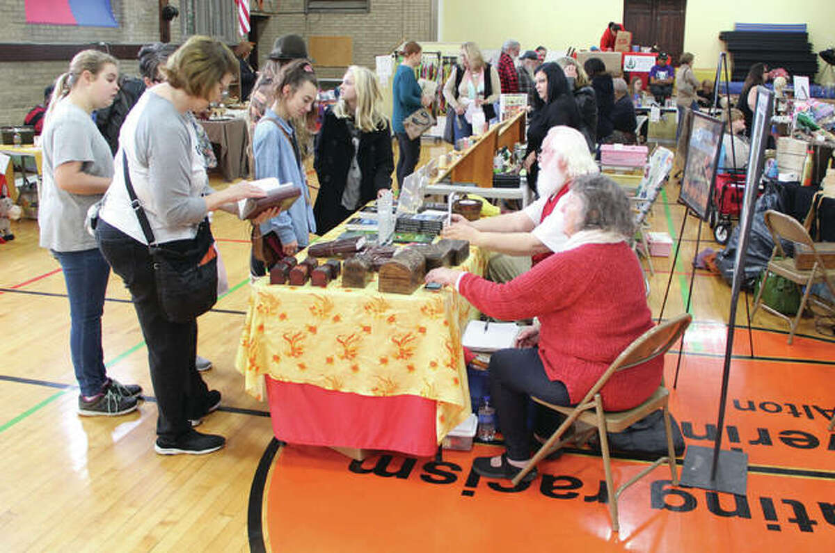 People look over hand-made and recycled items Saturday at the Green Gift Bazaar at the Alton YWCA. The bazaar features handmade or recycled gifts, and is put on by the Sierra Club and Alton Main Street in conjunction with the larger Small Business Saturday program.