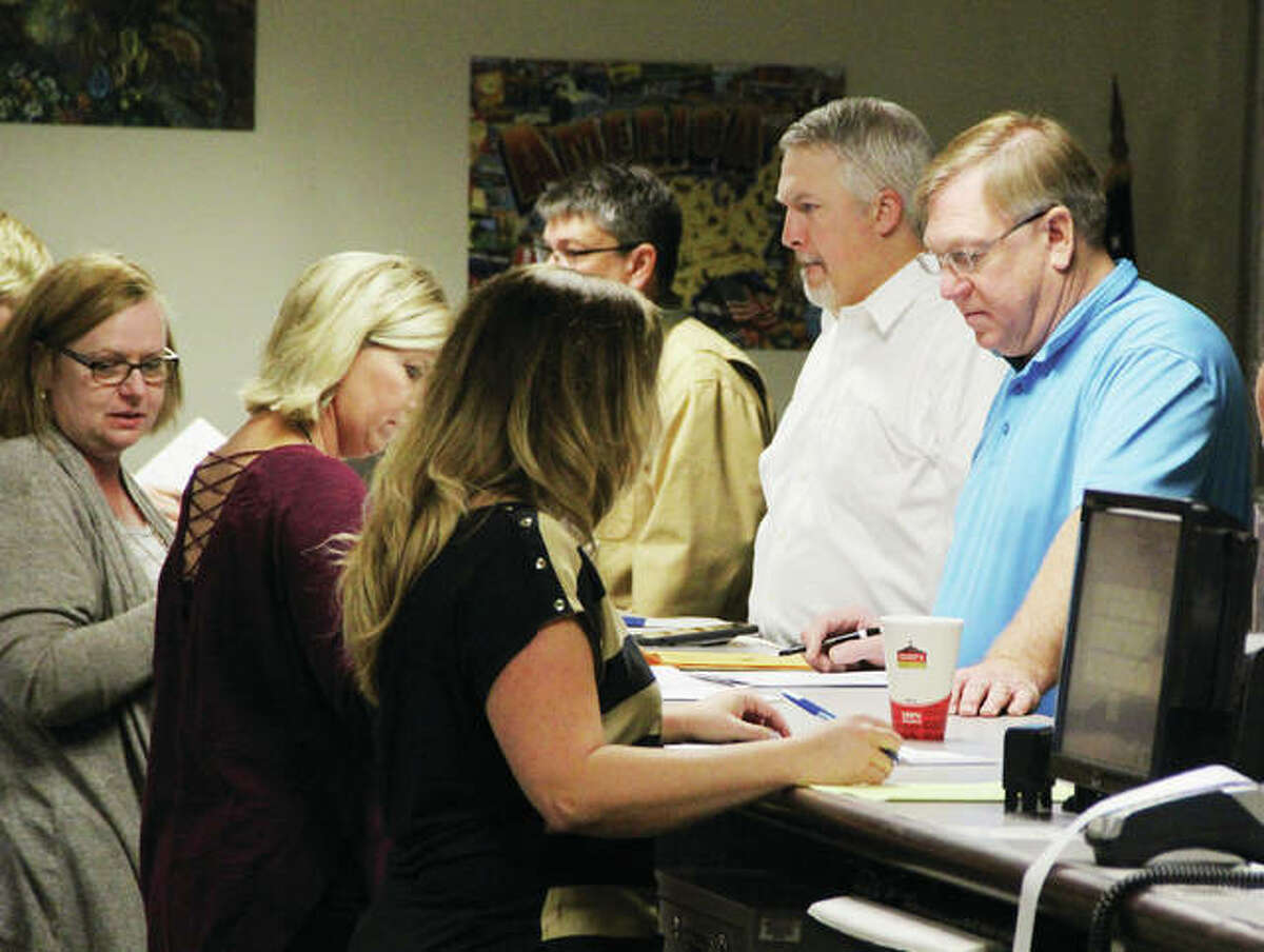 Candidates file for the March Primary Election Monday at the Madison County Clerks Office. About 35 candidates for county offices and precinct committeeman spots were in line to file petitions when the office opened. Filing continues until Monday, Dec. 4.