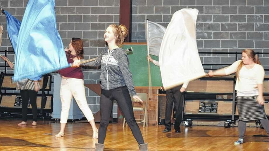 Members of the Jacksonville High School Winter Guard practice their routine Friday night at the high school before leaving for the soloist preliminary competition. Photo: Samantha McDaniel-Ogletree | Journal-Courier